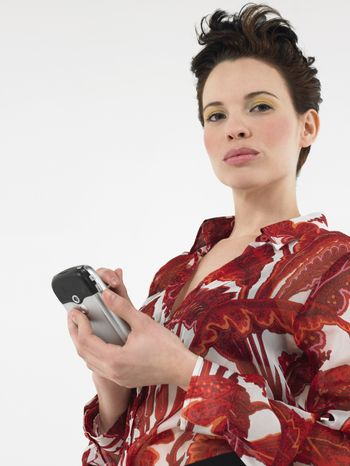 Portrait of attractive woman text messaging through cell phone