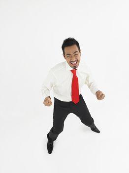 Man celebrating in studio full length