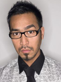 Man Wearing Glasses in studio portrait head and shoulders