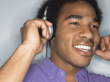 Man Listening to Headphones in studio head and shoulders