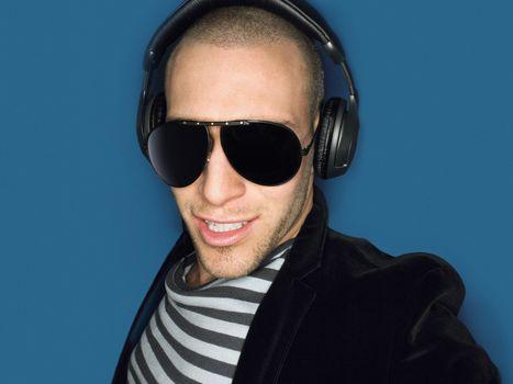 Man wearing headphones in studio head and shoulders