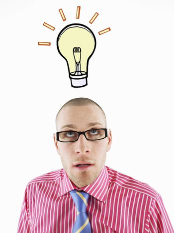 Man in glasses looking up head and shoulders below illustrated light bulb