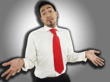 Man shrugging in front of spotlight effect half-length