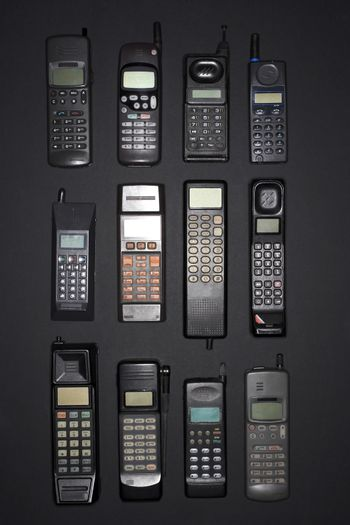 Row of old cell phones