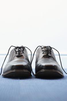 Pair of wingtip shoes