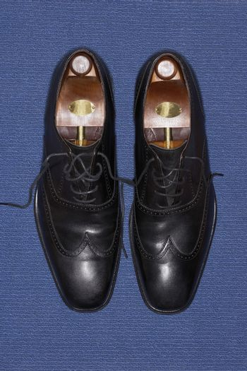 High angle view of wingtip shoes