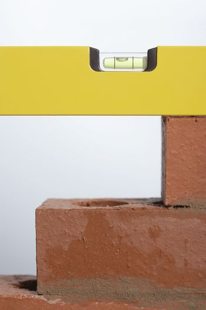 Closeup of spirit level on brick