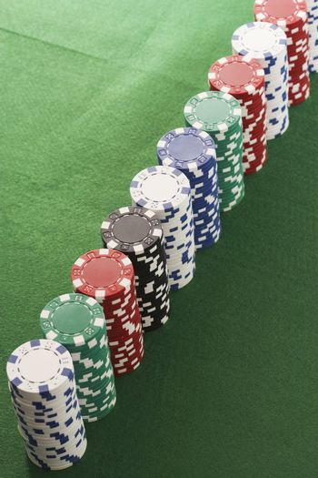 Casino chips stacked on green table