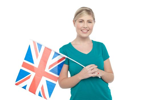 Young UK supporter holding national flag