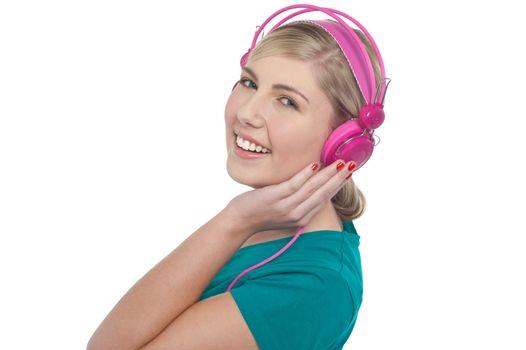 Blonde teen listening to music