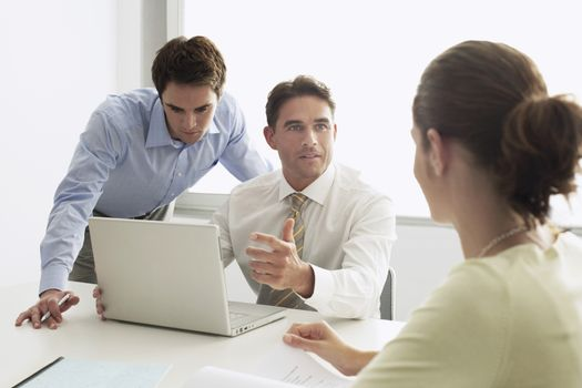 Business men and woman in meeting
