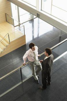 Businessmen talking on Mezzanine elevated view