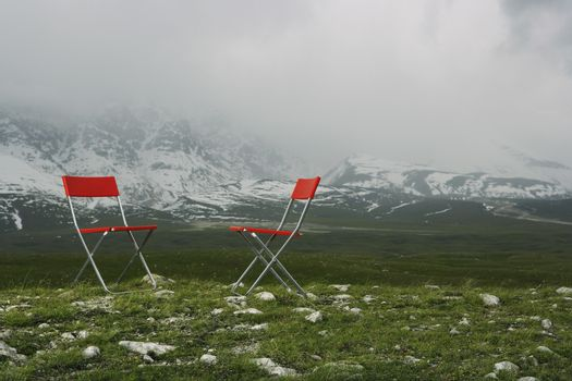 Chairs in Mountain Landscape
