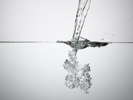 Jet splashing into water surface view