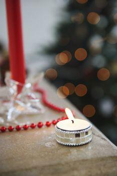 Closeup of lit tealight candles during Christmas