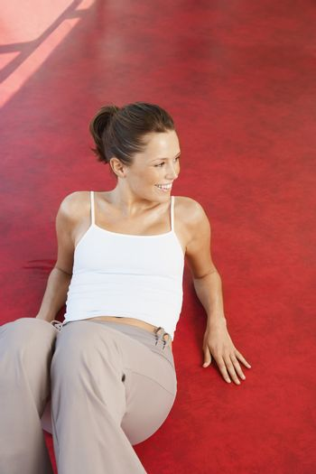 Woman Reclining on Floor in health club high angle view