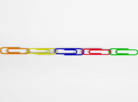 Multi colored paper clips in row
