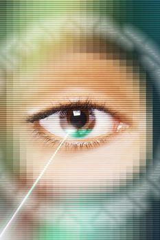 Laser beam on eye close up digital composite