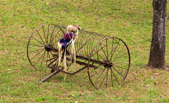 This doll couple on the old farm equipment represent the Autumn season arriving in North Carolina.