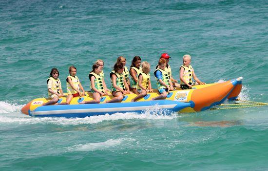 Children on banana boat ride