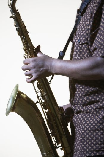 Saxophonist mid section side view
