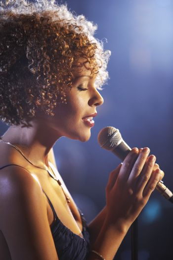 Closeup profile of a female jazz singer on stage