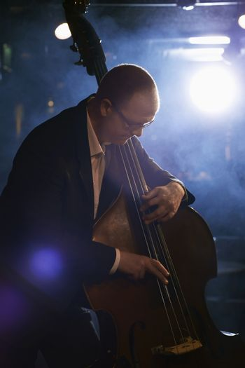 Man playing the double bass on stage