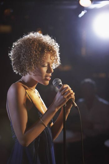 Profile shot of a female jazz singer on stage