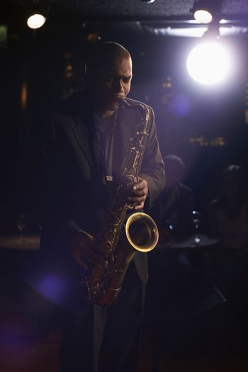 Musician playing saxophone in the jazz club