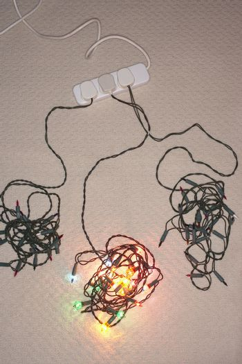 Tangled Christmas lights on floor elevated view