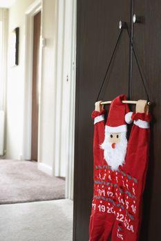 Santa Claus calendar hanging on wardrobe