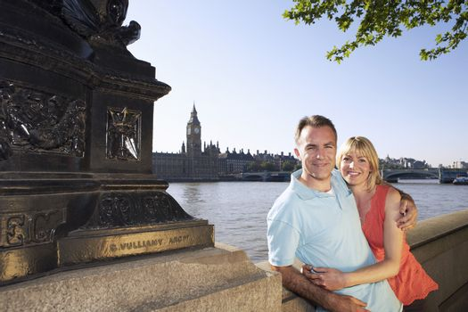 Vacationing couple standing by Thames River portrait