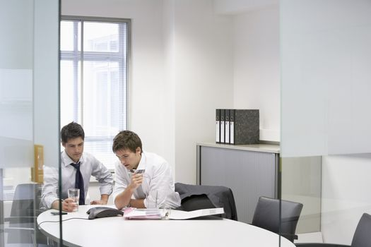 Two businessmen having conference call in office