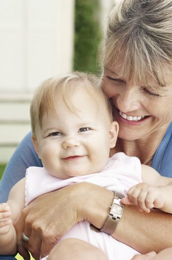 Closeup of a cheerful grandmother with granddaughter