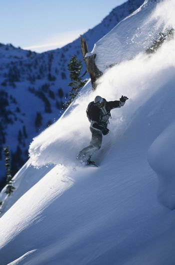Snowboarder on mountain slope