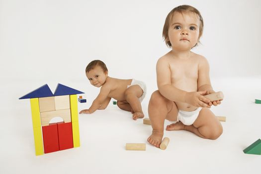 Babies Playing With Building Blocks