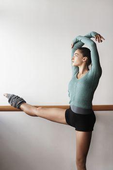 Ballet Dancer Stretching at bar