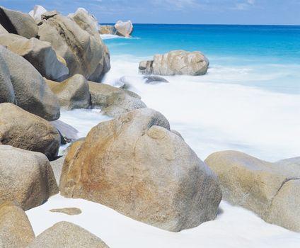 Spume along rocky coastline