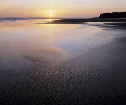 Tidal flats and ocean at sunset