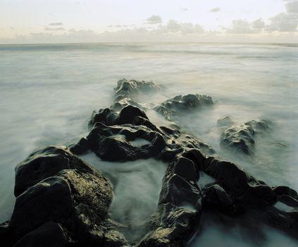 Mist among rocks at coast