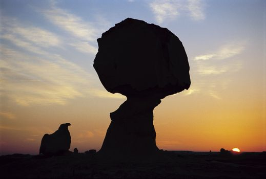Silhouette of rock at sunset