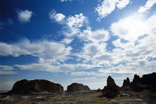 Barren landscape under cloudy sky
