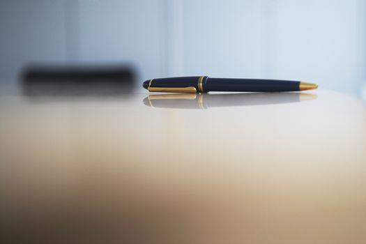 Closeup of pen on desk