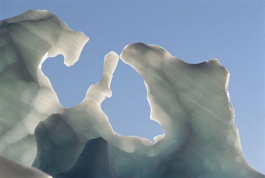 Melting iceberg against clear sky