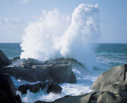 Waves crashing on rocks at coast