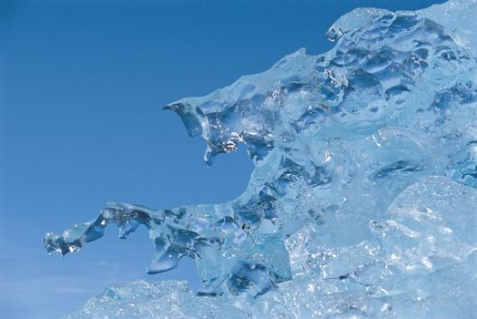 Closeup of ice melting against clear sky