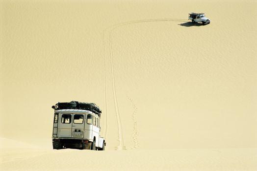 Safari vehicles driving in desert