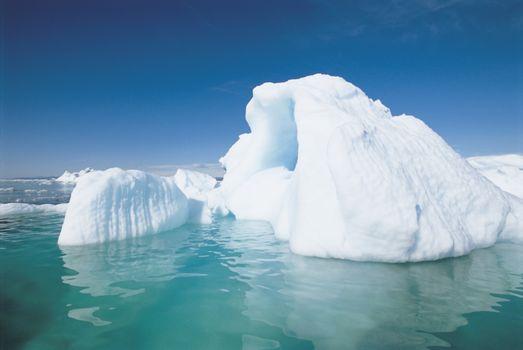 Large iceberg against sky