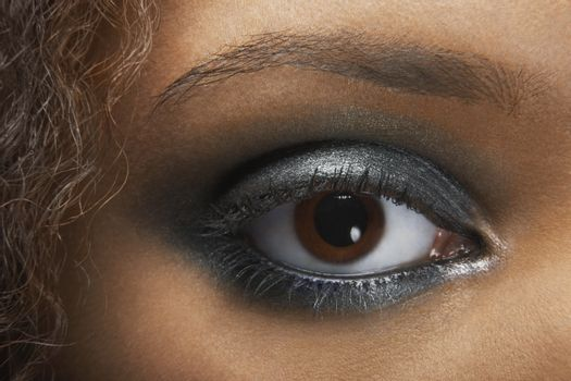 Detail image of young woman's eye with silver eye shadow