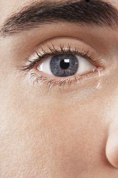 Detail image of man's eye crying